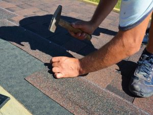 Roofing contractor installing roof tiles